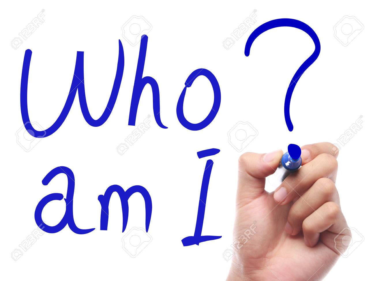 "Hand with pen is writing "" Who Am I"" on transparent white board."